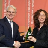 Gordon Campbell receives an award for his