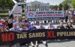 Environmentalists protest the proposed Keystone XL pipeline to Texas in front of the White House