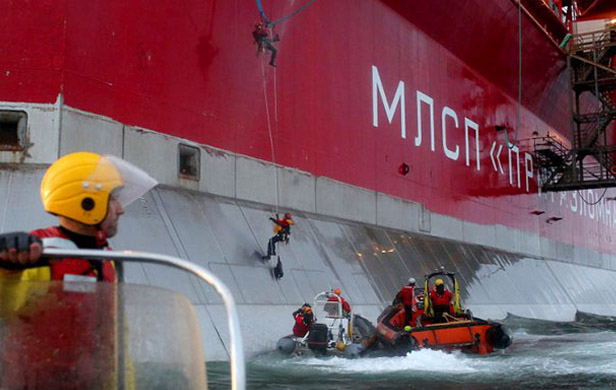 Russians storm Greenpeace ship with 2 Canadians, tow to port