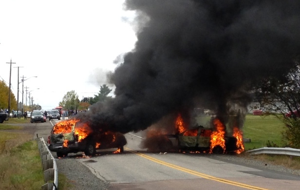 Two vehicles burn near a fracking protest in Rexton, N.B. (Courtesy of Gilles Boudreau)