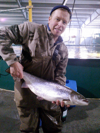 A Kuterra employee shows off one of its land-raised fish (Kuterra.com)