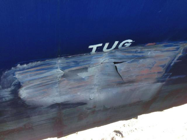 The CMA CGM Attila's damaged hull, after striking the dock at Vancouver's Centerm port (cell phone image)