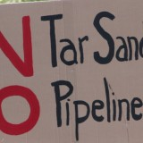 Sign of the Times: A placcard from the recent rally against expanded oil pipeline and tanker traffic through Vancouver