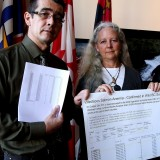 Chief Bob Chamberlin and salmon biologist Alexandra Morton display test results confirming ISAv is here in BC's wild salmon