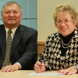 Disgraced Gitxsan Treaty Negotiator Elmer Derrick with Enbridge VP Janet Holder were all smiles in December 2011 - prior to their deal falling apart