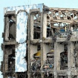 The badly damaged reactor 4 building, with its exposed spent fuel ponds, at Japan's Fukushima Daiichi nuclear plant