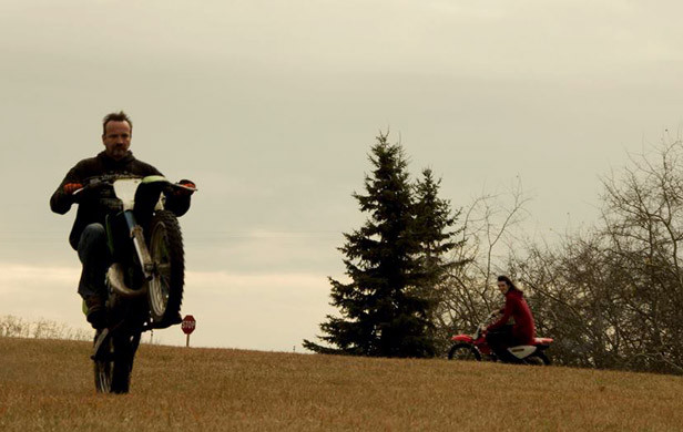 Alex (right) and father (left) riding dirt bikes. (Photo: Matt Sutton's Facebook)