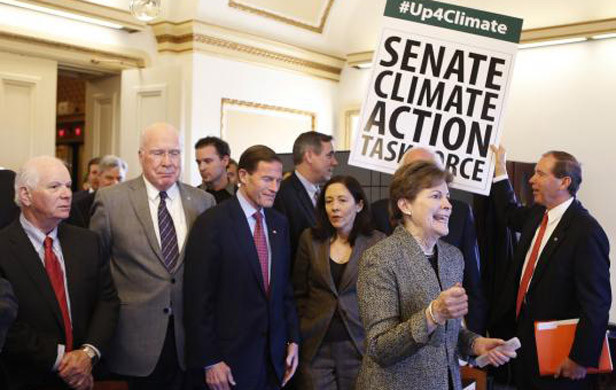 U.S. Senators from the Senate Climate Action Task Force urge action on climate change in Washington (Photo: Yuri Gripas, Reuters).