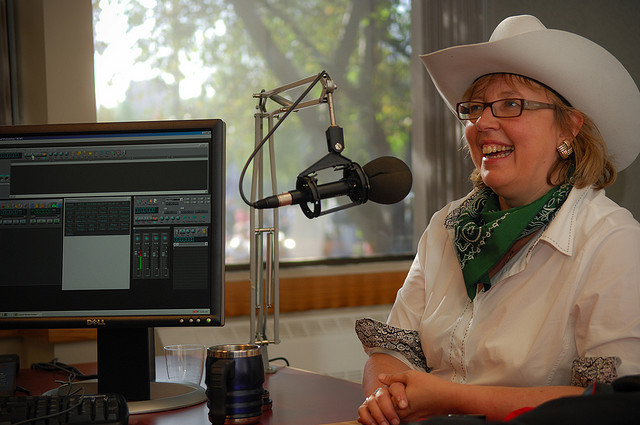 Elizabeth May being interviewed during Calgary Stampede (Flickr/ItzaFineDay CC licence)