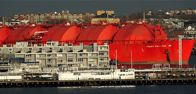 A typical LNG tanker in a harbour - larger than an apartment block