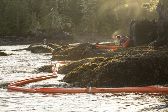 One pof many Heiltsuk responders who have remained on the scene for weeks, working on the spill that threatens their waters and seafood harvesting (Photo: Tavish Campbell)