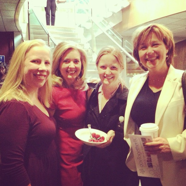 Pamela Martin (red dress) & Premier Clark (r) 2012 courtesy Amber Strocel via Flickr (CC BY SA, 2.0 Lilcense)